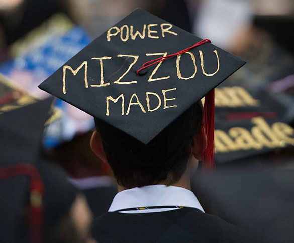 "Student wearing mortarboard with ""Power Mizzou Made"" painted on it"