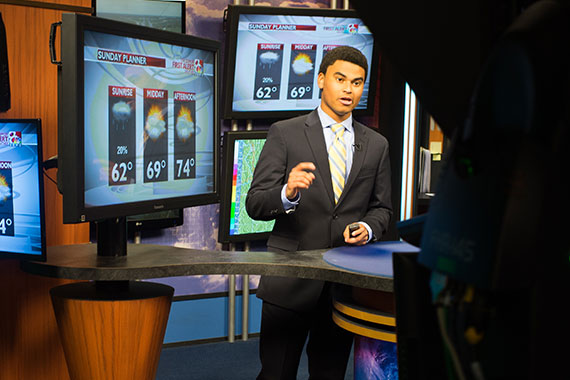 Student doing weather at KOMU TV station
