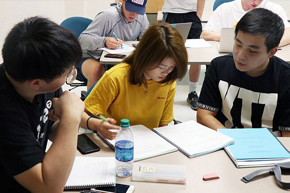 Three students working in study group