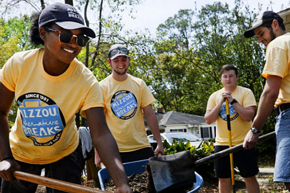 Mizzou Alternative Breaks students shoveling dirt