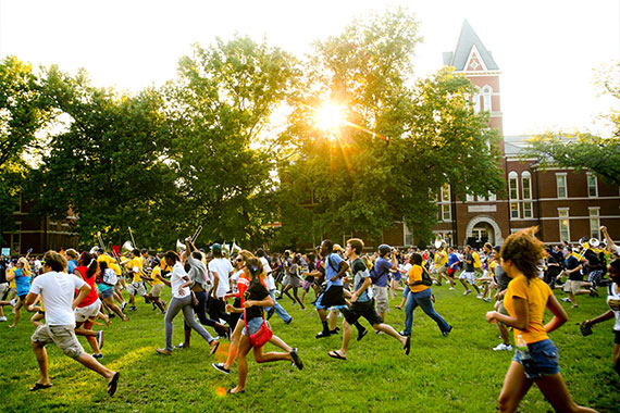 First year students running through the Columns during Tiger Walk
