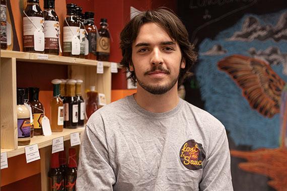 Jack Schroeder in his Lost in Sauce storefront