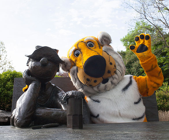 Truman Tiger waving with arm around Beetle Bailey statue