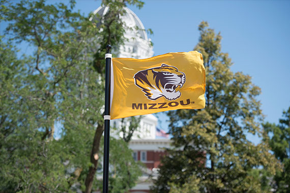 Mizzou Tiger logo flag in front of Jesse Hall