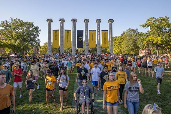 Incoming first-year students walk through the Columns during Tiger Walk