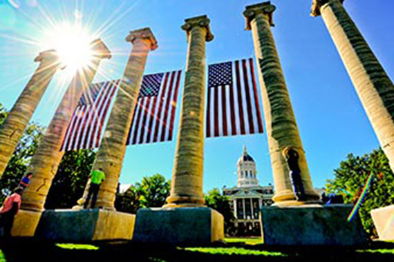 Flags fly from the Columns in front of Jesse