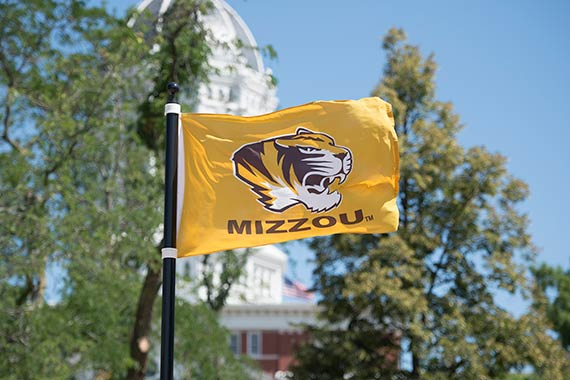 Mizzou flag with Jesse Hall in background